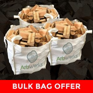 three bulk bags full of logs